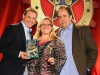 Sandi Masori gets AEMMY award from Mike Koenigs and Paul Colligan