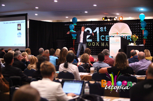 Conference Decorations Stage Backdrop (Mike Koenigs on stage)
