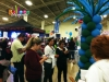 crowd gathers to opt in to marketing list at trade show booth