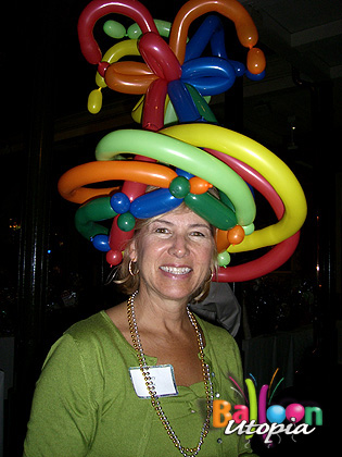 Who can help but smile while wearing a silly balloon hat?