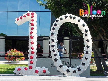 "Callaway golf celebrated 10 years of their popular drive ""Big Bertha"" with large number sculptures"