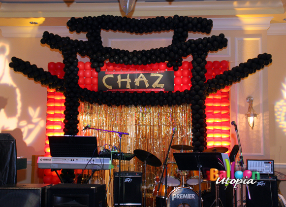 Stage backdrop sets the scene for Asian themed event
